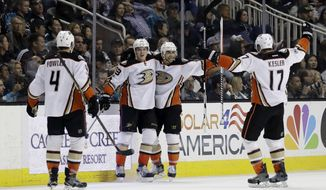 Anaheim Ducks' Jakob Silfverberg, center left, celebrates his goal with teammates Andrew Cogliano, center right, Cam Fowler (4) and Ryan Kesler (17) during the second period of an NHL hockey game against the San Jose Sharks Saturday, March 18, 2017, in San Jose, Calif. (AP Photo/Marcio Jose Sanchez)