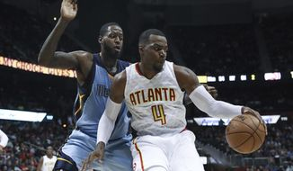 Atlanta Hawks forward Paul Millsap (4) controls the ball while being defended by Memphis Grizzlies forward JaMychal Green (0) during the second half of am NBA game, Thursday, March 16, 2017, in Atlanta. The Grizzlies defeated the Hawks 103-91. (AP Photo/Branden Camp)