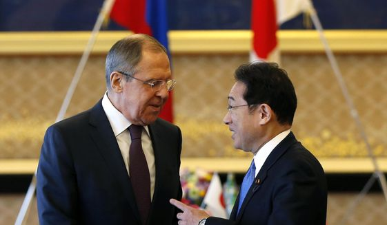 "Russian Foreign Minister Sergei Lavrov, left, talks with Japanese Foreign Minister Fumio Kishida at the start of their meeting as a part of Japan-Russia foreign and defence ministers meeting at Iikura guest house in Tokyo, Japan Monday, March 20, 2017.  The foreign and defense ministers from Japan and Russia are meeting in Tokyo for the first ""two-plus-two"" talks since Russia's annexation of Ukraine. (Issei Kato/Pool Photo via AP)"