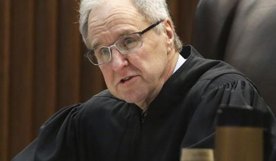 Kansas Supreme Court Justice Eric Rosen asks questions Thursday, March 16, 2017, during oral arguments in a legal fight over a state law banning a second-trimester abortion procedure and the larger question of whether the state constitution's Bill of Rights offered a fundamental right to an abortion.(Thad Allton/The Topeka Capital-Journal via AP, Pool)