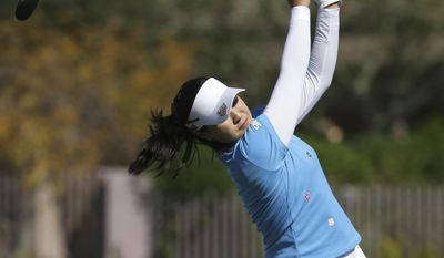 In Gee Chun, of South Korea, tees off on the 8th tee during the final round of a LPGA golf tournament on Sunday, March 19, 2017, in Phoenix, Ariz. (AP Photo/Rick Scuteri)