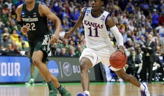 Kansas' Josh Jackson (11) advances the ball to the basket as Michigan State' Miles Bridges (22) gives chase in the second half of a second-round game in the men's NCAA college basketball tournament in Tulsa, Okla., Sunday, March 19, 2017. (AP Photo/Tony Gutierrez)