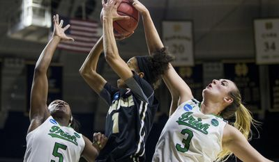 Notre Dame's Jackie Young (5) and Jackie Young (5) work together to block a shot by Purdue's Ashley Morrissette (1) during the first half of a second-round game in the NCAA women's college basketball tournament, Sunday, March 19, 2017, in South Bend, Ind. (AP Photo/Robert Franklin)