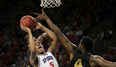 Richmond's Nick Sherod (5) lines up a shot while Oakland's Jalen Hayes attempts to block him during a second-round NIT NCAA men's college basketball game Sunday, March 19, 2017, in Richmond, Va. (Shelby Lum/Richmond Times-Dispatch via AP)