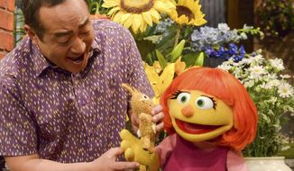"""This image released by Sesame Workshop shows Julia, a new autistic muppet character debuting on the 47th Season of """"Sesame Street,"""" on April 10, 2017, on both PBS and HBO. (Zach Hyman/Sesame Workshop via AP)"""
