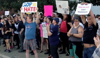 Protesters rallied last year outside the North Carolina Executive Mansion in Raleigh after the governor signed a bill that dealt a blow to the LGBT movement by preventing localities from passing anti-discrimination rules. (Associated Press)