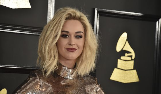 """Katy Perry arrives at the 59th annual Grammy Awards at the Staples Center in Los Angeles, Feb. 12, 2017. In an acceptance speech for an award at a Human Rights Campaign dinner on March 18, 2017, in Los Angeles, Perry said she """"prayed the gay away"""" during her """"unconscious adolescence.""""  (Photo by Jordan Strauss/Invision/AP, File)"""
