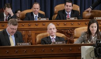 Members of the House Permanent Select Committee on Intelligence near the end of five hours of questioning of FBI Director James Comey and National Security Agency Director Adm. Michael Rogers on allegations of Russian interference in the 2016 U.S. presidential election, on Capitol Hill in Washington, Monday, March 20, 2017. From left on bottom row, Rep. Rick Crawford, R-Ark., Rep. Trey Gowdy, R-S.C., Rep. Elise Stefanik, R-N.Y., and from left on top row, Rep. Jim Himes, D-Conn., Rep. Adam Schiff, D-Calif., the ranking member, and Chairman Rep. Devin Nunes, R-Calif. (AP Photo/J. Scott Applewhite) ** FILE **