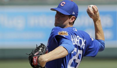 Chicago Cubs' Kyle Hendricks throws during the first inning of the team's spring training baseball game against the Colorado Rockies, Monday, March 20, 2017, in Scottsdale, Ariz. (AP Photo/Darron Cummings)