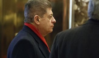 FILE- In this Dec. 15, 2016, file photo, Judge Andrew Napolitano waits for an elevator in the lobby of Trump Tower in New York. Fox News Channel has pulled legal analyst Napolitano from the air after disavowing his on-air claim that British intelligence officials had helped former President Barack Obama spy on Donald Trump.  The move was first reported by The Los Angeles Times on Monday, March 20, 2017. (AP Photo/Evan Vucci, File)