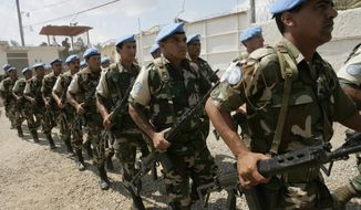 FILE - In this March 26, 2006, file photo, U.N. troops from Uruguay march during a transitional ceremony at the U.N. Spain base in Forte-Liberte, Haiti. Uruguay's president Tabare Vazquez said Monday, March 20, 2017, that his country is pulling its soldiers out of a United Nations peacekeeping mission in Haiti, where they have served since 2004. (AP Photo/Ariana Cubillos, File)