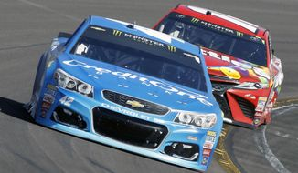Kyle Larson (42) drives out of Turn 4 ahead of Kyle Busch during the NASCAR Cup Series auto race at Phoenix International Raceway, Sunday, March. 19, 2017, in Avondale, Ariz. Larson finished second in the race. (AP Photo/Ralph Freso)