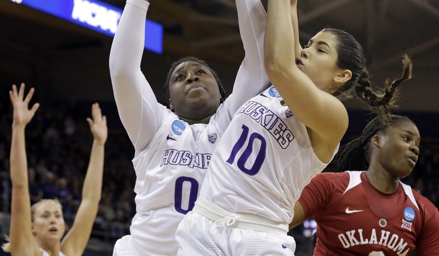 Washington's Chantel Osahor (0) grabs a rebound next to teammate Kelsey Plum (10) and Oklahoma's Vionise Pierre-Louis, right, during the first half of a second-round game in the NCAA women's college basketball tournament Monday, March 20, 2017, in Seattle. (AP Photo/Elaine Thompson)