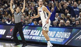 Connecticut's Kia Nurse reacts after hitting a 3-point basket in the first half of a second-round game against Syracuse in the NCAA women's college basketball tournament, Monday, March 20, 2017, in Storrs, Conn. (AP Photo/Jessica Hill)