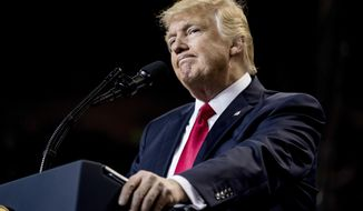 President Donald Trump pauses while speaking at a rally at the Kentucky Exposition Center in Louisville, Ky., Monday, March 20, 2017. (AP Photo/Andrew Harnik)