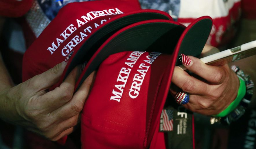 Supporters of President Trump are holding on to their beliefs, polls and analysts say. (Associated Press/File)