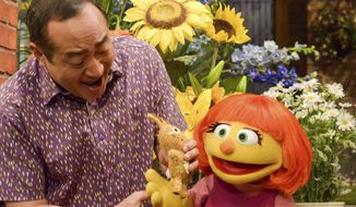 "This image released by Sesame Workshop shows Julia, a new autistic muppet character debuting on the 47th Season of ""Sesame Street"" on April 10, 2017, on both PBS and HBO. (Zach Hyman/Sesame Workshop via AP) ** FILE **"