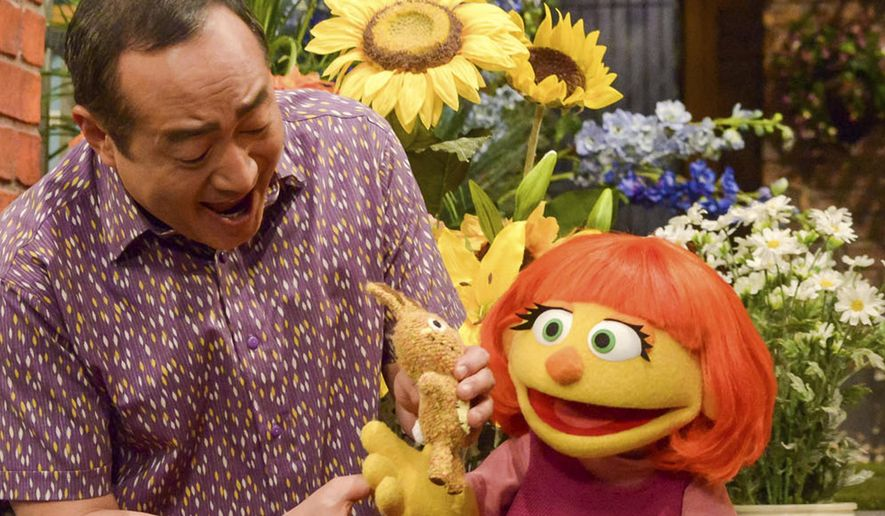 """This image released by Sesame Workshop shows Julia, a new autistic muppet character debuting on the 47th Season of """"Sesame Street"""" on April 10, 2017, on both PBS and HBO. (Zach Hyman/Sesame Workshop via AP) ** FILE **"""