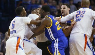 From left, Oklahoma City Thunder guard Semaj Christon (6) and guard Russell Westbrook, Golden State Warriors forward Draymond Green (23) and guard Klay Thompson, and Thunder forward Taj Gibson (22) get into a tussle during the second quarter of an NBA basketball game in Oklahoma City, Monday, March 20, 2017. (AP Photo/Sue Ogrocki)