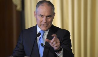 "Environmental Protection Agency Administrator Scott Pruitt has agreed with President Trump's intention to return the agency to its ""core mission"" of ensuring clean air and clean water. (Associated Press)"