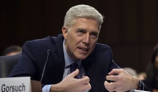 Supreme Court Justice nominee Neil Gorsuch testifies on Capitol Hill in Washington on Tuesday during his confirmation hearing before the Senate Judiciary Committee. His rulings on the Chevron case have drawn criticism from the Senate. (AP Photo/Susan Walsh)
