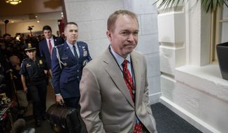 "Budget Director Mick Mulvaney arrives at the Capitol with President Donald Trump to rally support for the Republican health care overhaul, in Washington, Tuesday, March 21, 2017. Mulvaney wrote in a memo late last week that until the full budget release in May, ""all public comments of any sort should be limited to the information contained in the Budget Blueprint chapter for your agency,"" referring to the 53-page document released last Thursday. (AP Photo/J. Scott Applewhite)"
