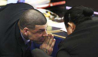 Former New England Patriots football player Aaron Hernandez speaks to defense attorney Michelle Medina during his double murder trial in Suffolk Superior Court, Tuesday, March 21, 2017, in Boston. Hernandez is on trial for the July 2012 killings of Daniel de Abreu and Safiro Furtado who he encountered in a Boston nightclub. The former New England Patriots NFL football player is already serving a life sentence in the 2013 killing of semi-professional football player Odin Lloyd.   (Pat Greenhouse /The Boston Globe via AP, Pool)