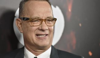 """In this Oct. 25, 2016, file photo, Tom Hanks arrives at a special screening of """"Inferno"""" at the Directors Guild of America Theatre in Los Angeles. (Photo by Jordan Strauss/Invision/AP, File)"""