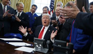 President Donald Trump speaks in the Oval Office of the White House in Washington, Tuesday, March 21, 2017, after signing a bill to increase NASA's budget to $19.5 billion and directs the agency to focus human exploration of deep space and Mars.  (AP Photo/Evan Vucci)