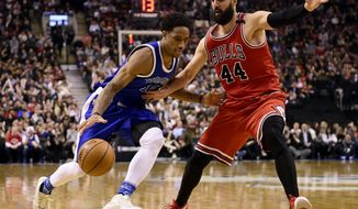 Toronto Raptors guard DeMar DeRozan (10) drives past Chicago Bulls forward Nikola Mirotic (44) during the second half of an NBA basketball game in Toronto, Tuesday, March 21, 2017. (Frank Gunn/The Canadian Press via AP)