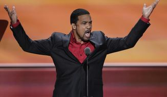 """File-This July 20, 2016, file photo shows Darrell Scott, Senior Pastor of New Spirit Revival Center Ministries speaking during the third day of the Republican National Convention in Cleveland. A Cleveland-area minister who told President Donald Trump that Chicago's """"top gang thugs"""" wanted to meet with him to find ways to reduce gun violence said the decision to cancel the event had nothing to do with criticism from activists in the city. The Rev. Scott said the meeting won't happen Tuesday, March 21, 2017, at a hotel near O'Hare International Airport because three people he wanted to attend, including an education expert who became ill at an airport, had to cancel. (AP Photo/J. Scott Applewhite, File)"""