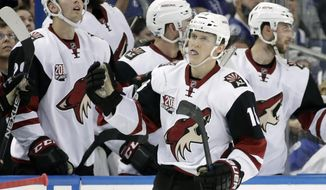 Arizona Coyotes center Christian Dvorak (18) celebrates with the bench after scoring against the Tampa Bay Lightning during the second period of an NHL hockey game Tuesday, March 21, 2017, in Tampa, Fla. (AP Photo/Chris O'Meara)