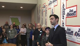 """In this photo taken March 11, 2017, Georgia Democratic congressional candidate Jon Ossoff speaks to volunteers in his Cobb County campaign office. Ossoff is trying for an upset in a Republican-leaning district outside Atlanta. The primary is April 18 with a likely runoff on June 20. Republicans have begun to attack Ossoff, a move the candidates says """"shows we can win."""" (AP Photo/Bill Barrow)"""