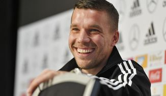 Germany's forward Lukas Podolski smiles during  a press conference prior the friendly soccer match between Germany and England in Dortmund, Germany, Tuesday, March 21, 2017. Podolski will play his last match for the national team against England on Wednesday. (AP Photo/Martin Meissner)