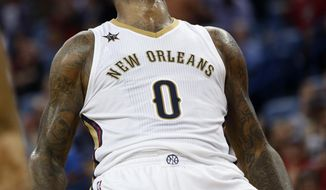 New Orleans Pelicans forward DeMarcus Cousins (0) reacts after being fouled while scoring in the second half of an NBA basketball game against the Memphis Grizzlies in New Orleans, Tuesday, March 21, 2017. The Pelicans won 95-82. (AP Photo/Gerald Herbert)