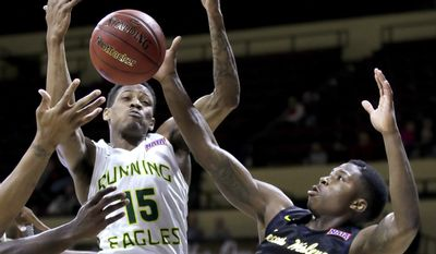 Life's Dalarian Williams (15) and Texas Wesleyan's Ryan Harris (10) battle for a rebound during the first half of the NAIA national championship basketball game Tuesday, March 21, 2017, in Kansas City, Mo. (AP Photo/Charlie Riedel)
