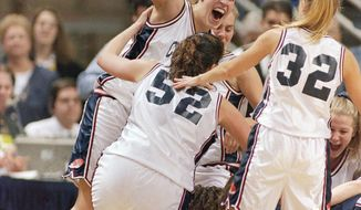 FILE - In this April 3, 1995, file photo, UConn's Rebecca Lobo, left, celebrates with teammates including Kara Wolters (52) and Pam Weber (32) after they defeated Virginia 67-63 to win the NCAA East Regional Championship, in Storrs, Conn. No current UConn player was even born the last time this program had a losing streak. And that mark is safe for at least another year, which has Rebecca Lobo thinking about popping the champagne with her former teammates _ the ones who actually lost two in a row. (AP Photo/John Dunn, File)