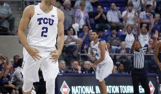 TCU guard Michael Williams (2) reacts to the three-point shot by guard Kenrich Williams, background, in the first half of an NCAA college basketball game in the NIT in Fort Worth, Texas, Tuesday, March 21, 2017. (Paul Moseley/Star-Telegram via AP)