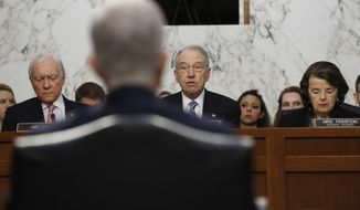 Supreme Court Justice nominee Neil Gorsuch, back to camera, listens as Senate Judiciary Committee Chairman Sen. Charles Grassley, R-Iowa, flanked by the committee's ranking member Sen. Dianne Feinstein, D-Calif., right, and Sen. Orrin Hatch, R-Utah speaks on Capitol Hill in Washington, Tuesday, March 21, 2017, during the committee's confirmation hearing for Gorsuch.  (AP Photo/Pablo Martinez Monsivais)