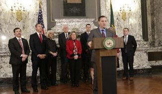Sen. John Braun, joined by fellow Republican senators, speaks at a news conference about a two-year $43 billion budget proposal, Tuesday, March 21, 2017 in Olympia, Wash. The budget puts an additional $1.8 billion toward education. (AP Photo/Rachel La Corte)