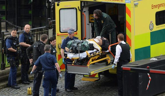 """The attacker outside the Houses of Parliament in London on Wednesday was treated by emergency services but died as a result of gunshot wounds from city police. Authorities say they are treating the incident """"as a terrorist incident until we know otherwise."""" (Associated Press)"""