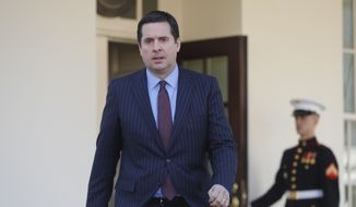 House Intelligence Committee Chairman Rep. Devin Nunes, R-Calif, walks out the White House in Washington, Wednesday, March 22, 2017, to speak with reporters after a meeting with President Donald Trump. (AP Photo/Pablo Martinez Monsivais)