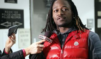 "FILE - In this Jan. 4, 2017, file photo, Cincinnati Bengals NFL football player Adam ""Pacman"" Jones speaks to reporters as he is released from the Hamilton County Justice Center in Cincinnati. Jones faces three misdemeanor charges, including assault, but no longer is charged with a felony for a January confrontation, Hamilton County Prosecutor Joe Deters  announced Wednesday, March 22, 2017.  The felony charge of harassment with a bodily substance was dismissed at the prosecuting attorney's request.  Deters says the misdemeanors also include disorderly conduct and obstructing official business. (AP Photo/John Minchillo, File)"