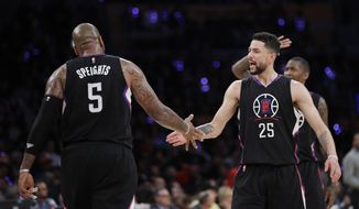 Los Angeles Clippers' Marreese Speights, left, is congratulated by Austin Rivers after making a basket during the first half of an NBA basketball game against the Los Angeles Lakers Tuesday, March 21, 2017, in Los Angeles. (AP Photo/Jae C. Hong)