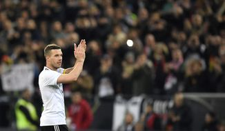 Germany's Lukas Podolski applauds as he leaves the pitch during the friendly soccer match between Germany and England in Dortmund, Germany, Wednesday, March 22, 2017. (AP Photo/Martin Meissner)