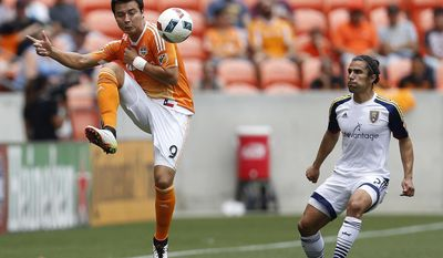 FILE - In this May 15, 2016, file photo, Houston Dynamo forward Erick Torres (9) plays the ball during the first half of an MLS soccer game against Real Salt Lake at BBVA Compass Stadium,in Houston. Torres looks as if he's back to his old self with Houston, energized by coach Wilmer Cabrera. (Karen Warren/Houston Chronicle via AP, File)