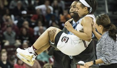 South Carolina guard Allisha Gray is carried off the court after an injury during a second-round game in the NCAA women's college basketball tournament against Arizona State on Sunday, March 19, 2017, in Columbia, S.C. South Carolina won, 71-68. (AP Photo/Sean Rayford)