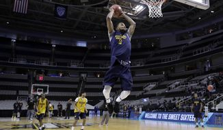 West Virginia 's Tarik Phillip goes up for a dunk during practice Wednesday, March 22, 2017, in San Jose, Calif., in preparation for an NCAA Tournament college basketball regional semifinal game. West Virginia faces Gonzaga on Thursday. (AP Photo/Marcio Jose Sanchez)