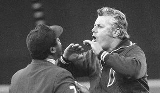 FILE - In this Sept. 21, 1979, file photo, Philadelphia Phillies manager Dallas Green shouts at umpire Eric Gregg after Gregg reversed a decision in favor of the Pittsburgh Pirates during the sixth inning of a baseball game in Philadelphia. Green, the tough-talking manager who guided the Philadelphia Phillies to their first World Series championship, died Wednesday, March 22, 2017, at Hahnemann University Hospital in Philadelphia, the Phillies said. He was 82. Green spent 62 years in baseball as a player, manager, general manager, team president and other roles.  (AP Photo/Rusty Kennedy, File)