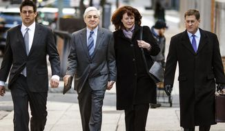 Former Penn State president Graham Spanier, second left,  and his wife Sandra, arrives for the third day of his trial at the Dauphin County Courthouse in Harrisburg, Pa., on Wednesday, March 22, 2017.  Spanier is charged with conspiracy and endangering the welfare of children. Prosecutors say Spanier and two other Penn State administrators failed to act on a report of sexual abuse by former football coach Jerry Sandusky. (Dan Gleiter/PennLive.com via AP)